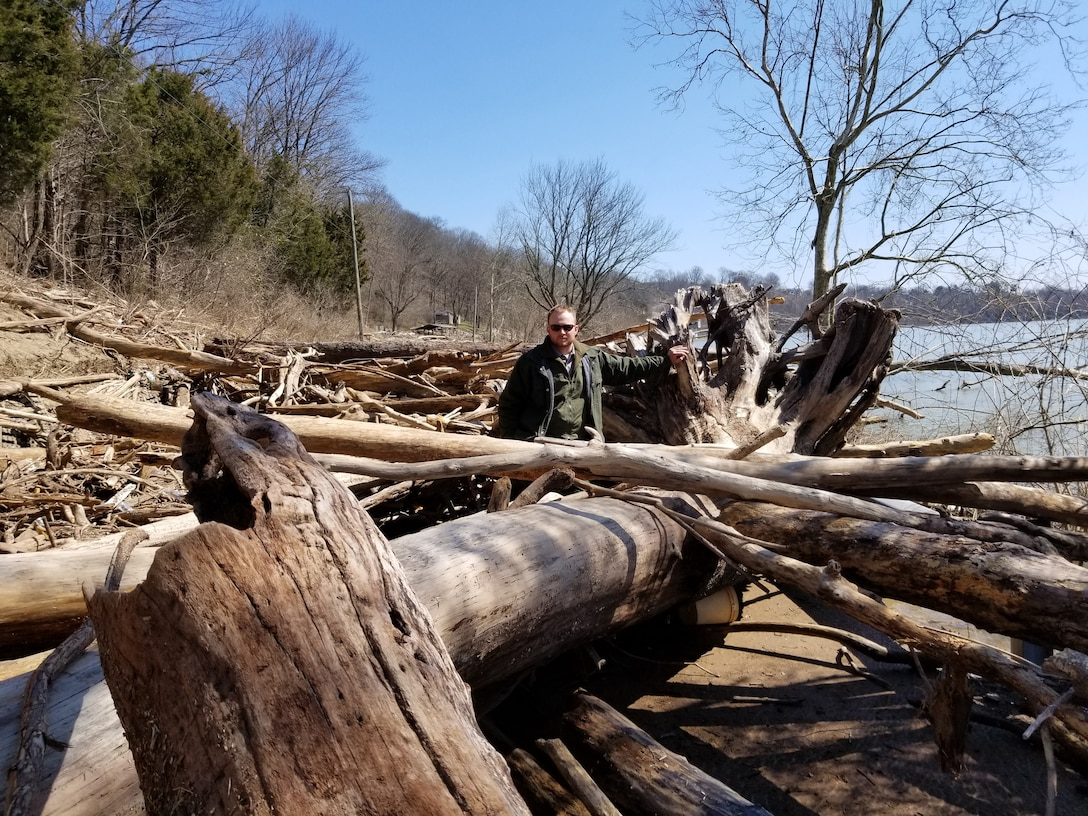 Park Ranger Tanner Rich stands in a debris field, which covers the road into Waitsboro Recreation Area March 19, 2019 on the shoreline of Lake Cumberland in Somerset, Ky. This photo was taken before cleanup operations began following high water at the U.S. Army Corps of Engineers Nashville District operated project. (USACE Photo)