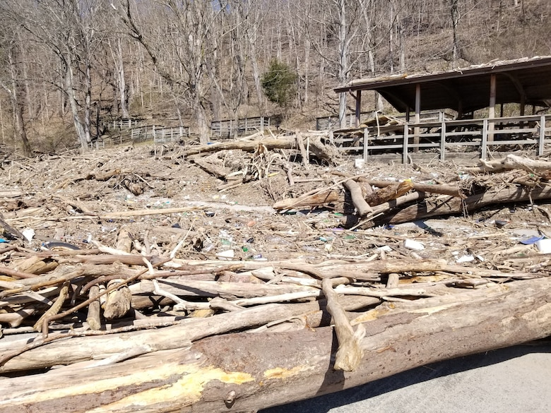 Debris covers the road into Waitsboro Recreation Area March 19, 2019 on the shoreline of Lake Cumberland in Somerset, Ky., before clean up operations began following high water at the U.S. Army Corps of Engineers Nashville District operated project. (USACE Photo)