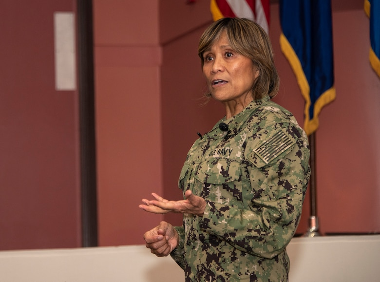 U.S. Navy Vice Adm. Raquel C. Bono, Defense Health Agency, Defense Health Headquarters director, delivers remarks to members of David Grant USAF Medical Center, April 23, 2019, at Travis Air Force Base, California. Bono's briefing focused on the rollout of the Military Health System GENESIS, the Department of Defense's new electronic health record, which the 60th Medical Group will use exclusively beginning in September 2019. (U.S. Air Force photo by Heide Couch)