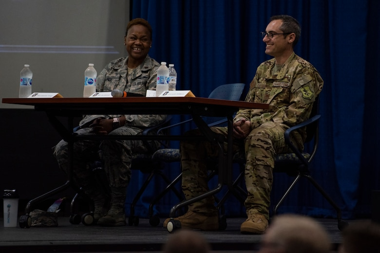Col. Justin Demarco (right), 23 Wing vice commander, and fellow judge Maj. Lakeatta Tonge (left) from the 23d Medical Squadron, laugh during the second annual Moody Spark Tank competition, May 3, 2019, at Moody Air Force Base, Ga. The competition allows Airmen to showcase their ingenuity by presenting various time and money saving ideas that can benefit the Air Force. (U.S. Air Force photo by Airman 1st Class Joseph P. Leveille)