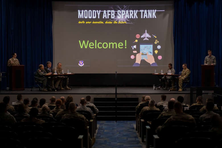 Audience members listen as the emcees introduce the judges during the second annual Moody Spark Tank competition May, 3, 2019, at Moody Air Force Base, Ga. The competition allows Airmen to showcase their ingenuity by presenting various time and money saving ideas that can benefit the Air Force. Teams were given five minutes to present their ideas, followed by four minutes of questions from the judges and culminating in a final decision round to announce the winners. (U.S. Air Force photo by Airman 1st Class Joseph P. Leveille)