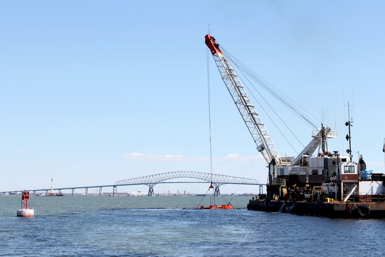A U.S. Army Corps of Engineers contracted dredge operated by Norfolk Dredging lifts material out of Curtis Bay Channel in Baltimore Harbor Tuesday March 19, 2019 as part of maintenance dredging of channels associated with the Baltimore Harbor and Channels Project. Curtis Bay Channel was one of six dredged during the Fiscal Year 2019 maintenance cycle, during which crews removed nearly 2.6 million cubic yards of material from channels to ensure continued safe navigation for vessels traveling to and from Port of Baltimore facilities.