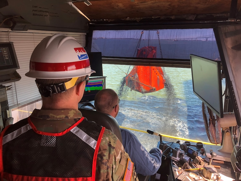 U.S. Army Corps of Engineers, Baltimore District Deputy Commander Lt. Col. Geoffrey Kuhlman looks on aboard an Army Corps contracted dredge operated by Norfolk Dredging as a load of material is pulled from the bottom of Curtis Bay Channel in Baltimore Harbor Tuesday March 19, 2019 as part of maintenance dredging of channels associated with the Baltimore Harbor and Channels Project. Curtis Bay Channel was one of six dredged during the Fiscal Year 2019 maintenance cycle, during which crews removed nearly 2.6 million cubic yards of material from channels to ensure continued safe navigation for vessels traveling to and from Port of Baltimore facilities.