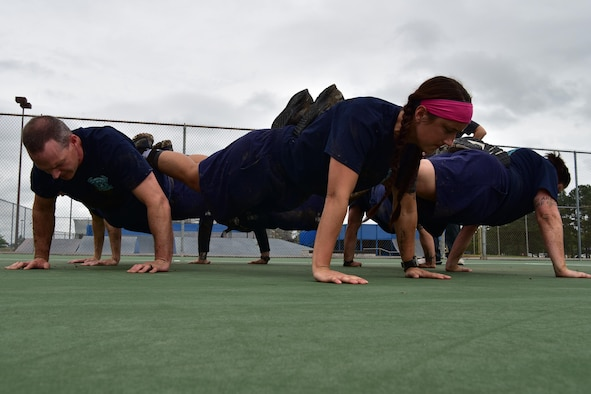 Fire Department volunteers perform a team pushup.