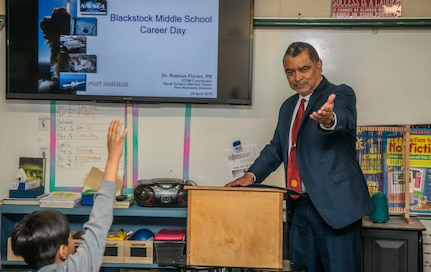 Ramon Flores, the science technology engineering and mathematics (STEM) coordinator at Naval Surface Warfare Center, Port Hueneme Division gives a presentation to students at Blackstock Middle School as part of a career day event, April 26.