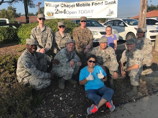 Volunteers from Vandenberg Air Force Base, Calif. and Norma Almanza, The Village Chapel Mobile Food Bank creator and event coordinator, pose for a phot after serving food at the mobile food bank Nov. 16, 2018, Vandenberg Village.