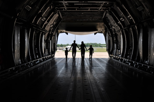 A 433rd Airlift Wing member and family walk through a static C-5M Super Galaxy May 5, 2019 at Joint Base San Antonio-Lackland, Texas.