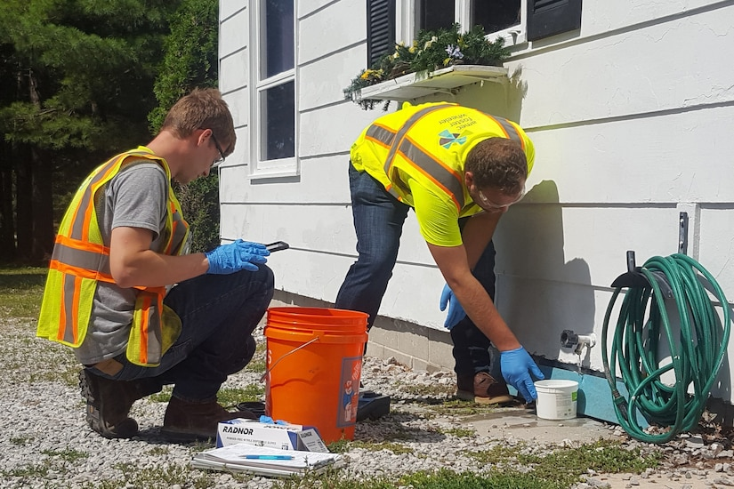 Workers sample drinking water