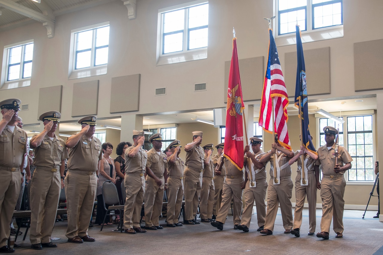 Sailors hold an indoor ceremony.