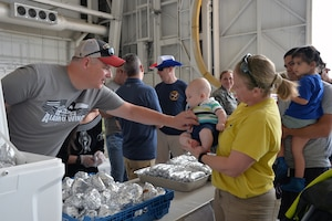 Col. Gregory Haynes, 433rd Operations Group commander, greets Sherry Justice, 356th Airlift Squadron operations superintendent, and her baby at the 433rd Airlift Wing family day May 5, 2019 at Joint Base San Antonio-Lackland, Texas.