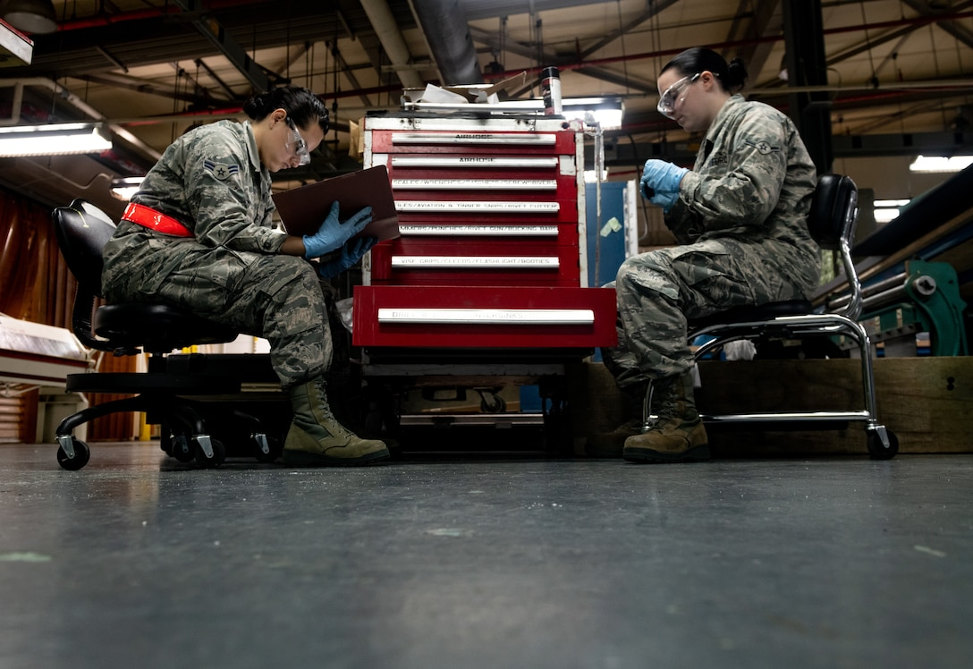 Airmen take inventory of a toolbox
