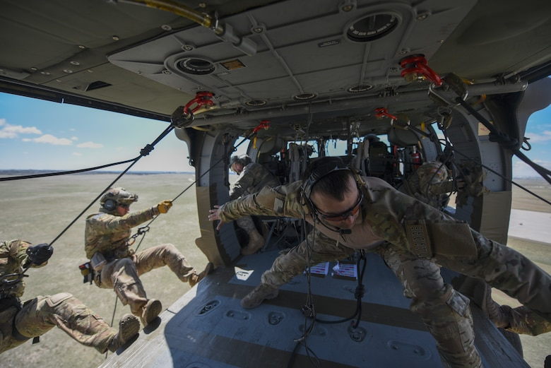 Airmen rappel out of an Black Hawk
