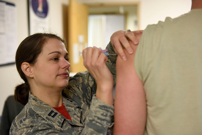 U.S. Air Force Captain Stephanie Smiddy, the infection and immunization officer-in-charge at the 180th Fighter Wing, Ohio Air National Guard, administers a vaccination, March 2, 2019, in Swanton, Ohio. Vaccinations ensure Airmen are ready to deploy anywhere in the world and to keep them healthy so they can continue to perform the mission. (U.S. Air National Guard photo by Staff Sgt. Shane Hughes)