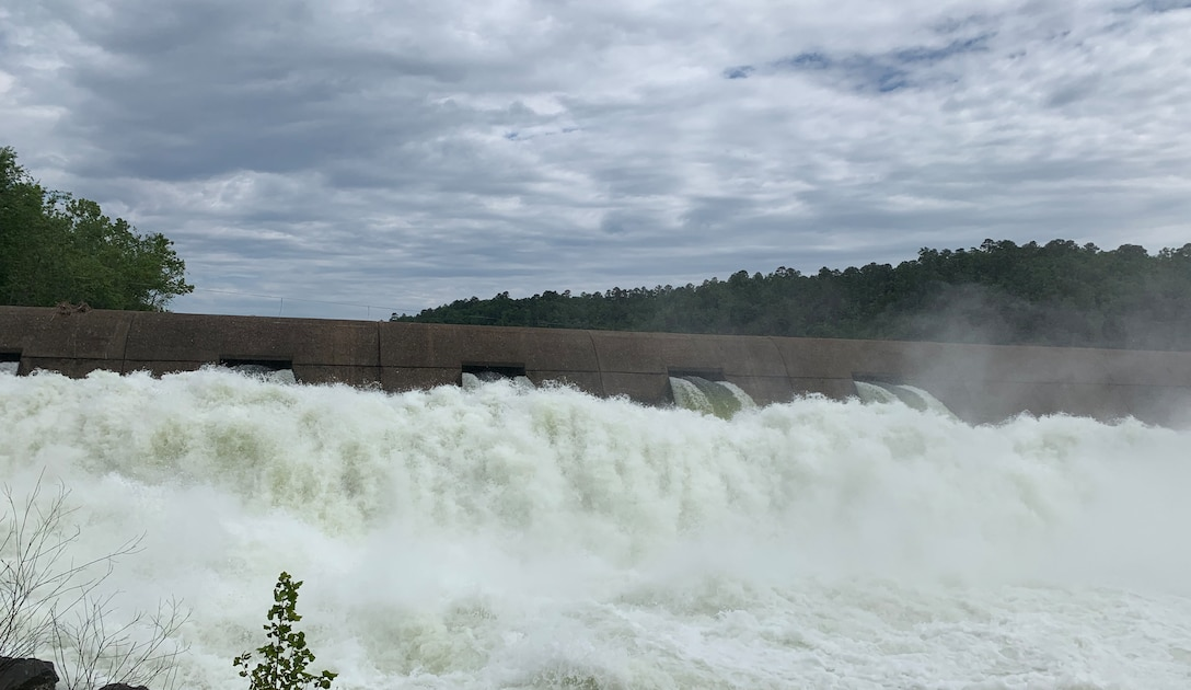 CAPTION - A reclamation dam below Broken Bow Dam in southeastern Oklahoma catches and releases about 3,300 cubic feet per second, May 7. The reclamation dam slows down releases from Broken Bow Dam just upstream and helps prevent downstream erosion by flattening and slowing the release. (Photo by Stacey Reese)