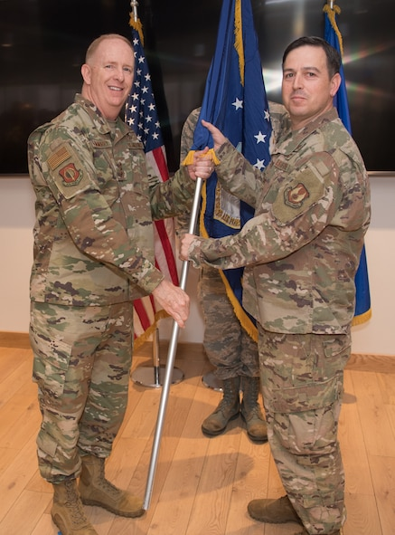 Col. Enrique Oti, right, receives the guidon for Air Force Life Cycle Management Center Detachment 12 from Center Commander Lt. Gen. Robert McMurry, left, May 8, 2019, during a detachment standup ceremony. Detachment 12's mission is to create and rapidly deliver software and applications for U.S. warfighters. (U.S. Air Force photo by Jerry Saslav)
