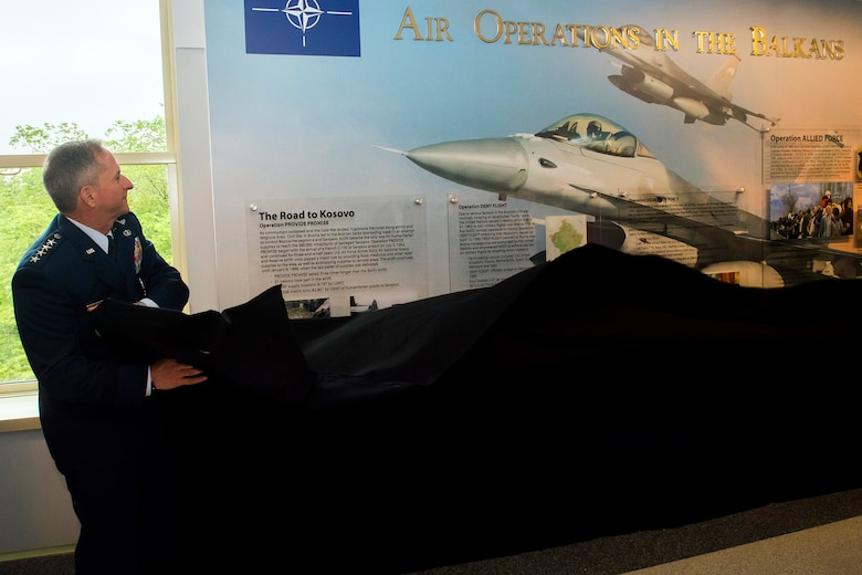 Air Force Chief of Staff Gen. David L. Goldfein pulls off a piece of cloth revealing a new display commemorating the 20th anniversary of Operation Allied Force during a ceremony at the Pentagon, Arlington, Va., May 8, 2019. Operation Allied Force was initiated in 1999 by NATO in response to Serbian President Slobodan Milosevic's campaign of ethnic cleansing of Kosovar Albanians. (U.S. Air Force photo by Adrian Cadiz)
