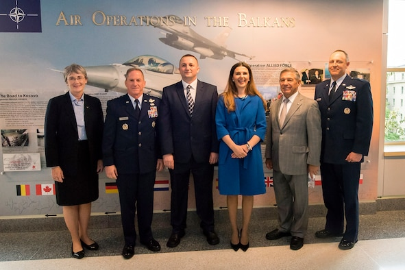 Secretary of the Air Force Heather Wilson, Air Force Chief of Staff Gen. David L. Goldfein, Muharren Alija, Ambassador of the Republic of Kosovo Vlora Çitaku, retired Lt. Gen. Dan Leaf, former 31st Fighter Wing and 31st Expeditionary Wing commander, Aviano Air Base, Italy and Brig. Gen. Chris Short, Aircrew Crisis Task Force director, pose for a photo in front of a new display commemorating the 20th anniversary of Operation Allied Force during a ceremony at the Pentagon, Arlington, Va., May 8, 2019. Operation Allied Force was initiated in 1999 by NATO in response to Serbian President Slobodan Milosevic's campaign of ethnic cleansing of Kosovar Albanians. (U.S. Air Force photo by Adrian Cadiz)
