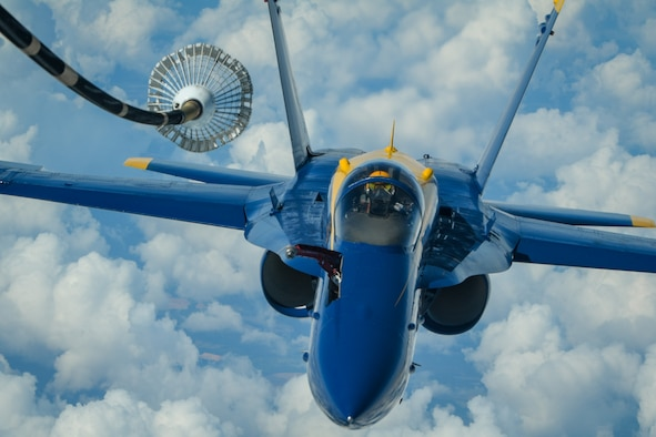 U.S. Navy Lt. James Cox, left wing pilot of the U.S. Navy Flight Demonstration Squadron, the Blue Angels, positions himself for centerline drogue air refueling from a KC-10 Extender flown by the 78th Air Refueling Squadron, 514th Air Mobility Wing, Joint Base McGuire-Dix-Lakehurst, N.J., May 8, 2019. The 78th ARS provided air refueling for the Blue Angels to move them to Joint Base Andrews, Md. for an air show. (U.S. Air Force photo by Senior Airman Ruben Rios)