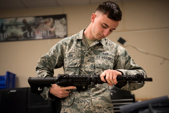 Airman First Class Zack Day, 366th Operation Support Squadron aircrew flight equipment apprentice, assembles a GUA-5A May 6, 2019, at Mountain Home Air Force Base, Idaho. The GUA-5A is a part of the ACES II survival kit that is provided for every aircrew member in the event they must eject into hostile territory. The weapon is easily assembled without tools and provides semi-automatic capabilities.