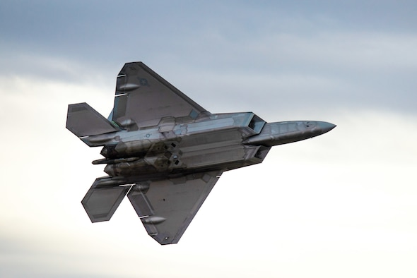 "U.S. Air Force Capt. Andrew ""Dojo"" Olson, F-35 Demo Team pilot and commander, flies through the sky over Davis-Monthan Air Force Base, March 2, 2019. Olson flew his new demonstration profile during the five-day Heritage Flight Course. (U.S. Air Force photo by Staff Sgt. Jensen Stidham)"
