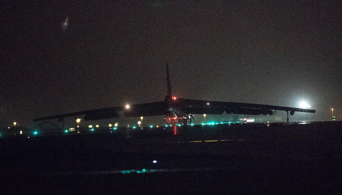 A photo of B-52 landing at night.