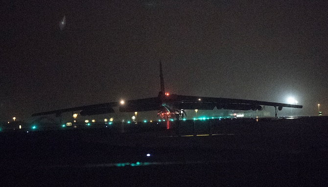 A photo of B-52 landing at night.