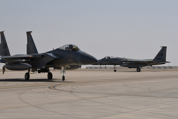 A photo of two F-15s.