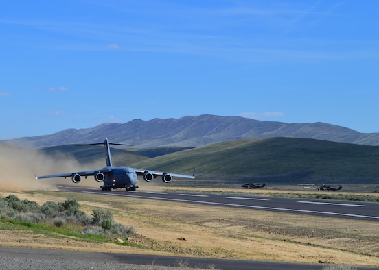 C-17 Globemaster III assigned to McChord Field takes off from Selah airstrip at Yakima Training Center May 1, 2019. Reserve Citizen Airmen from the 446th Airlift Wing delivered two Army UH-60 Black Hawk helicopters during a readiness exercise. It was the first time Reserve Citizen Airmen utilized the newly refurbished runway.
