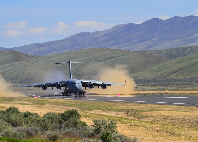 A C-17 Globemaster III piloted by a 446th Airlift Wing aircrew lands for the first time at the Selah airstrip May 1, 2019.