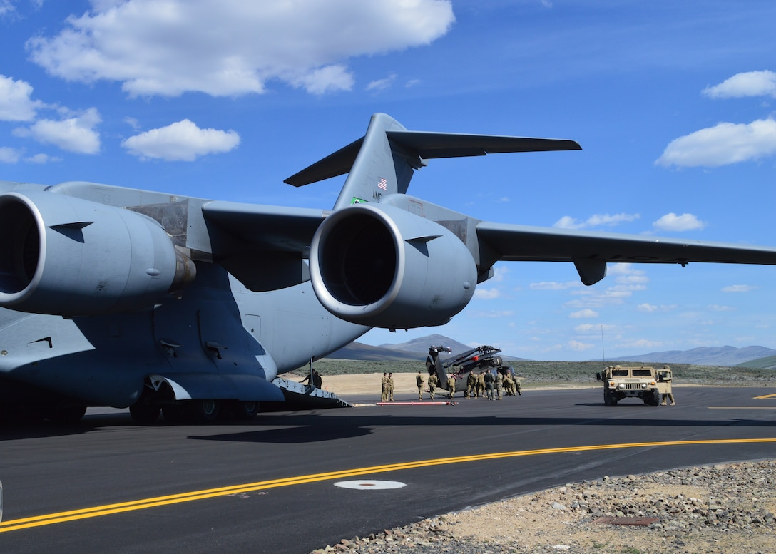 446th Airlift Wing loadmasters and active duty Soldiers assigned to unload a UH-60 Black Hawk from a C-17 Globemaster III at Selah airstrip May 1, 2019. It was the first time Reserve Citizen Airmen had utilized the newly refurbished runway at Yakima Training Center.