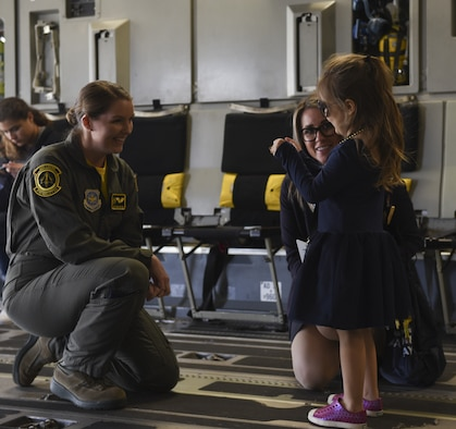 U.S. Air Force Airman 1st Class Taylor Clifton, 21st Airlift Squadron loadmaster, interacts with a young attendee May 4, 2019, at the Alaska Airlines Aviation Day in Seattle, Washington. More than 800 students were able to interact with 21st AS crew members from Travis Air Force Base, California, while touring the C-17 Globemaster III with the overall mission of inspiring youth to pursue potential careers in aviation and aerospace. (U.S. Air Force photo by Staff Sgt. Amber Carter)