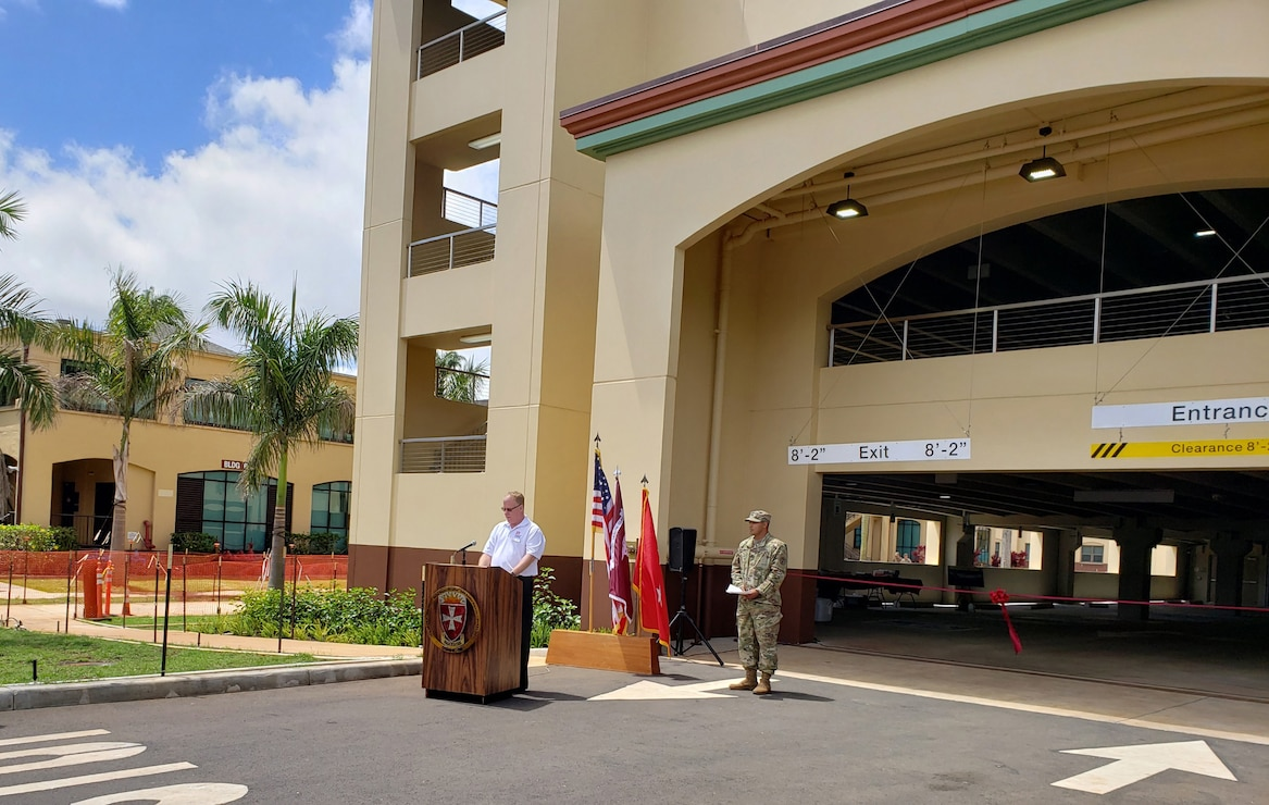 SCHOFIELD BARRACKS, Hawaii (April 24, 2019) -- Honolulu District's Tom Crump, military branch chief (at podium) provided remarks and participated in the ribbon cutting and grand opening ceremonies for the U.S. Army Health Clinic Schofield Barracks' new 181,000 sq. ft. parking garage. After the ceremonies, the five-level, $26 million Corps-built facility welcomed the first vehicles via the McCornack Road entrance. The garage, constructed by Swinerton Builders, adds 429 standard and 19 handicap parking spaces to the Schofield Barracks Health Clinic campus.