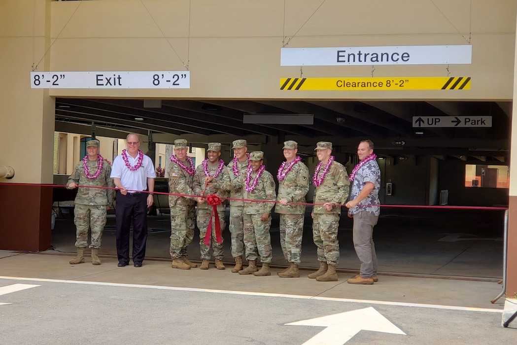 SCHOFIELD BARRACKS, Hawaii (April 24, 2019) -- Honolulu District's Tom Crump, military branch chief (second from left) provided remarks and participated in the ribbon cutting and grand opening ceremonies for the U.S. Army Health Clinic Schofield Barracks' new 181,000 sq. ft. parking garage. After the ceremonies, the five-level, $26 million Corps-built facility welcomed the first vehicles via the McCornack Road entrance. The garage, constructed by Swinerton Builders, adds 429 standard and 19 handicap parking spaces to the Schofield Barracks Health Clinic campus.