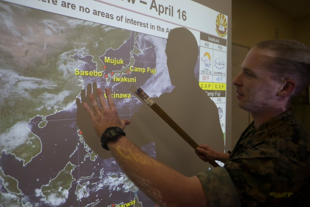 Cpl. John Stone, a meteorology and oceanography analyst forecaster with the 31st Marine Expeditionary Unit, briefs the daily forecast at Camp Hansen, Okinawa, Japan, April 16, 2019.