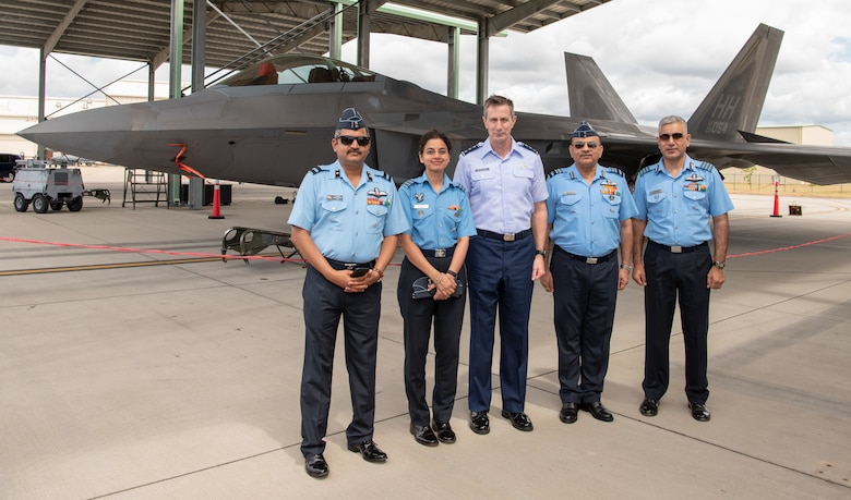 United States Air Force Lt. Gen. Kevin B. Schneider, 5th Air Force Commander, poses for a photo in front of an F-22 Raptor at Joint Base Pearl Harbor-Hickam with Indian Air Force attendees of the India Executive Steering Group, May 3, 2019. This year marks the 22nd iteration of the steering group between the two nations and is the primary venue for determining future engagements between the two air forces. (U.S. Air Force Photo by Staff Sgt. Daniel Robles)
