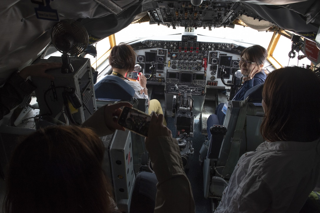 Tour participants view the cockpit of a KC-135 Stratotanker during a base tour of Kadena Air Base, Japan, May 8, 2019. The participants received a base mission brief and F-15 Eagle static display at Naha Air Base before traveling to Kadena for an 18th Wing mission brief and KC-135 Stratotanker static display. (U.S. Air Force photo by Tech. Sgt. Matthew B. Fredericks)