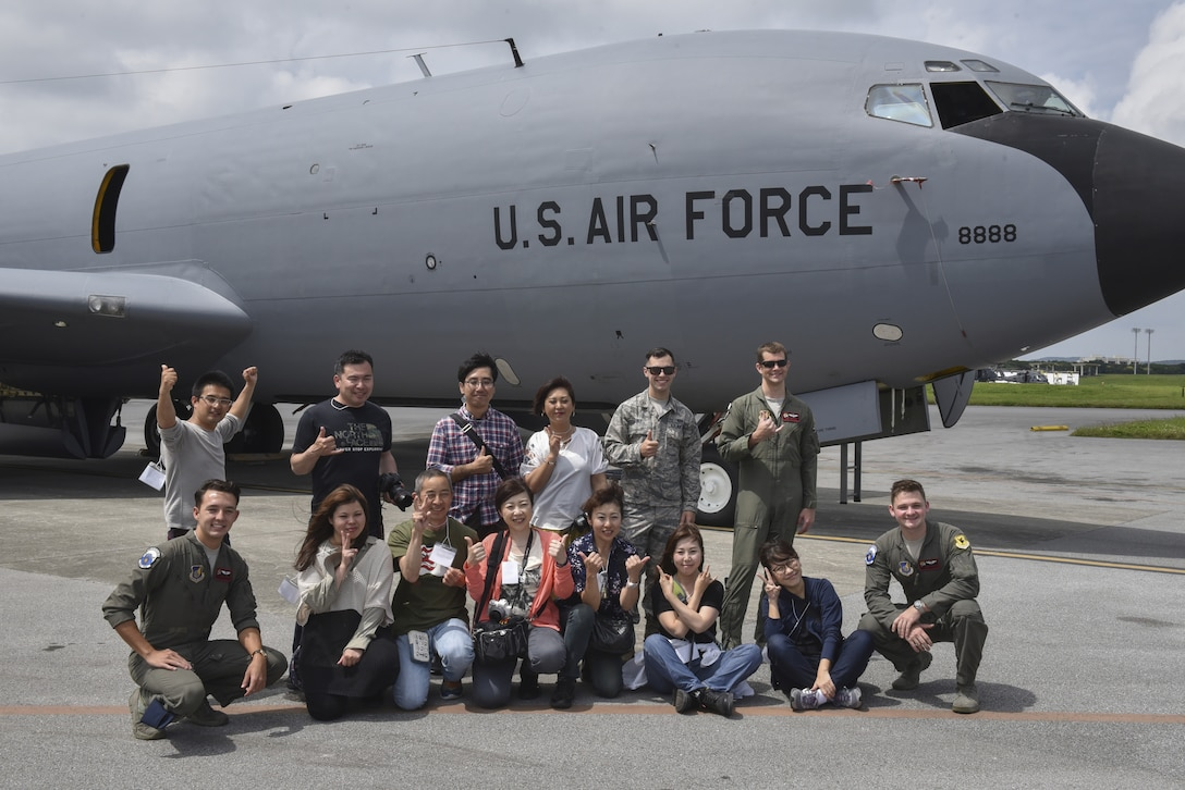 Tour participants pose for a group photo during a base tour of Kadena Air Base, Japan, May 8, 2019. The participants received a base mission brief and F-15 Eagle static display at Naha Air Base before traveling to Kadena for an 18th Wing mission brief and KC-135 Stratotanker static display. (U.S. Air Force photo by Tech. Sgt. Matthew B. Fredericks)