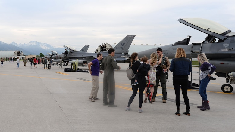 Previously deployed 510th Fighter Squadron Airmen are greeted by their families at Aviano Air Base, Italy, April 30, 2019. The Airman and Family Readiness Center provided various support programs for families of deployed members, including monthly family dinners. (U.S. Air Force photo by Senior Airman Kevin Sommer Giron)