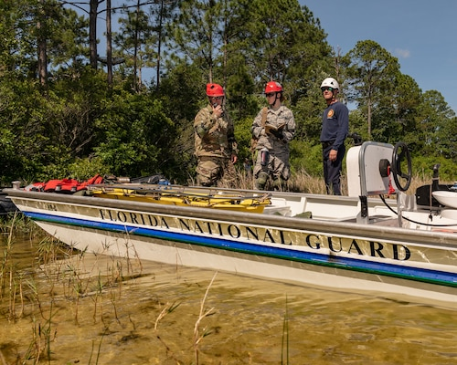 A task force team comprised of Florida National Guardsmen and civilian first responders rehearse a maritime rescue at Kingsley Lake on Camp Blanding Joint Training Center as part of the annual Search and Rescue Exercise.