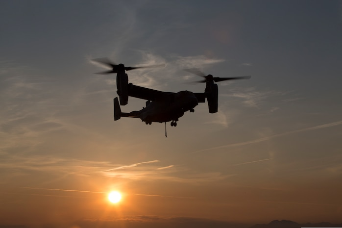 A U.S. Marine Corps MV-22B Osprey with Special Purpose Marine Air-Ground Task Force-Crisis Response-Africa 19.2, Marine Forces Europe and Africa, lands during external-lift training at Naval Air Station Sigonella, Italy, April 18, 2019. SPMAGTF-CR-AF is deployed to conduct crisis-response and theater-security operations in Africa and promote regional stability by conducting military-to-military training exercises throughout Europe and Africa.