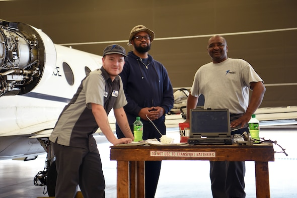 (Left to right) Alex Rayner, Terrence Herring and Billy Jackson, 48th Flying Training Squadron T-1A Jayhawk maintainers, take a break April 22, 2019, on Columbus Air Force Base, Miss. There are day, night and swing shifts maintaining 14th Flying Training Wing aircraft consistently to ensure pilots safety in the skies. (U.S. Air Force photo by Airman 1st Class Keith Holcomb)