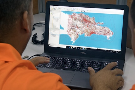 A communications operator with the Dominican Republic Ministry of Public Works and Communications creates virtual maps that depict weather effects like flooding in various regions of the Dominican Republic at the Emergency Operations Center in Santo Domingo, May 8, 2019.