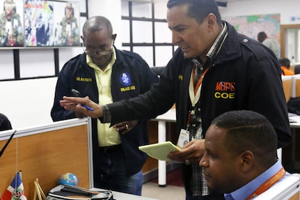 Liaisons from the Dominican Republic Ministry of Public Works and Communications and other civil organizations coordinate emergency-response efforts at the Emergency Operations Center in Santo Domingo, May 8, 2019.