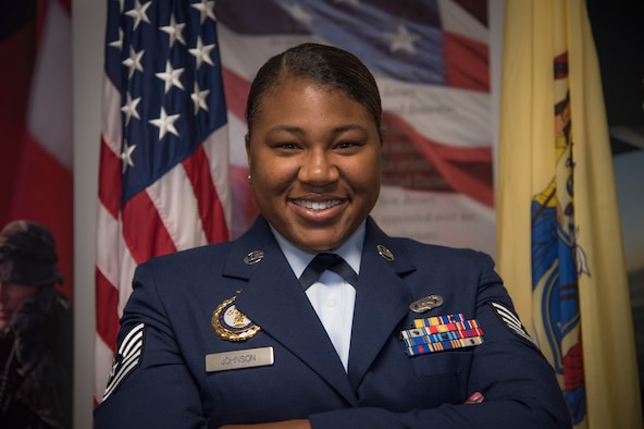 Tech Sgt. Jazlyn L. Johnson, a production recruiter of the 108th wing, poses for a photo at Joint Base McGuire-Dix-Lakehurst, N.J., May 2, 2019. Johnson was honored by thhe National Guard Bureau and inducted into their 100th Century Club for enlisting her 100th member into the Air National Guard. (U.S. Air National Guard photo by Airman 1st Class Andrea A. S. Williamson)