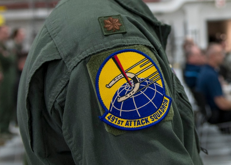 The members of the 491st ATKS removed the patches from their previous units and replaced them with the historic emblem that was last designed in 1944, during a squadron activation and assumption of command ceremony, May 8, 2019, on Hancock Field Air National Guard Base, N.Y. As they donned their new patches, a new generation revived the memory and traditions of the Ringers who served before them. (U.S. Air Force photo by Airman 1st Class Kindra Stewart)