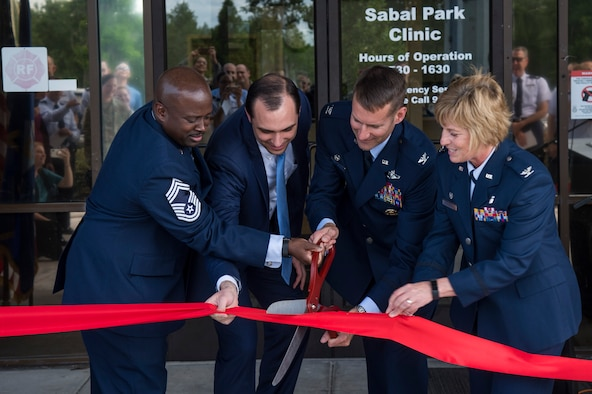 MacDill Air Force Base leadership cut the ribbon during the Sabal Park Clinic opening ceremony in Tampa, Fla., May 3, 2019.