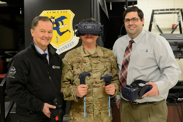 Bill Ehler, Business Development Manager of Capewell Aerial Systems (left), Master Sgt. Joseph Amato, 103rd Operations Group Evaluator Loadmaster, and Jared Burns, Director of Operations of Capewell Aerial Systems, take a break during a training session for the Virtual Reality Aerial Delivery Suite at Bradley Air National Guard Base on March 29, 2019. The VRADS system is designed to supplement training for loadmasters in a realistic virtual atmosphere. (U.S. Air Force photo by Staff Sgt. Chad Warren)