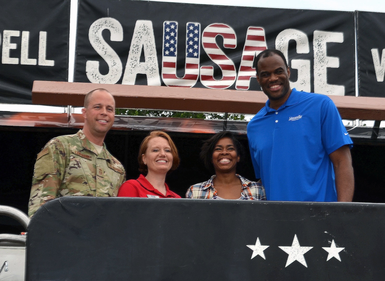 Former San Antonio Spurs legend David Robinson spoke to military spouses and children, signed autographs and shot some hoops during the Military Spouse Appreciation Day event at Joint Base San Antonio-Fort Sam Houston May 9. After his remarks, fans swarmed Robinson as he signed autographs, basketballs and Spurs memorabilia. He posed for photos and got to play basketball with some of the fans. Robinson was able to enjoy the food, including the sausage grilled at the event before heading out.
