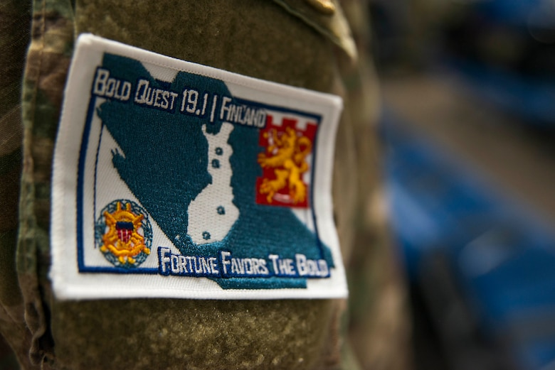 A patch worn by members of the 290th Joint Communications Support Squadron for exercise Bold Quest at MacDill Air Force Base, April 8, 2019. The patch pictures the country of Finland and the four locations Bold Quest exercises in. Bold Quest was originally conceived in 2001 as an Advanced Concept Technology Demonstration (ACTD), with the first operational demonstration in 2003. (U.S. Air Force photo by Airman 1st Class Frank Rohrig)
