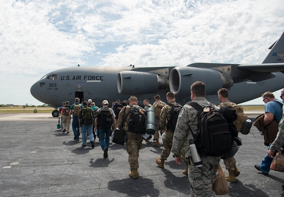 Members of the 290th Joint Communications Support Squadron board a C-17 Globemaster III aircraft at MacDill Air Force Base, Fla., April 8, 2019, for exercise Bold Quest. Bold Quest is an annual exercise where military and civilian members, developers and analysts work in a cooperative network with partner nations, finding technical and procedural solutions to improve coalition warfighting interoperability.
